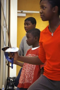Imani students Myles Mitchell, Malik Hill, and Breeana Johnson