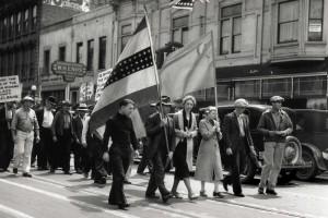 Communist Party members march down J Street.